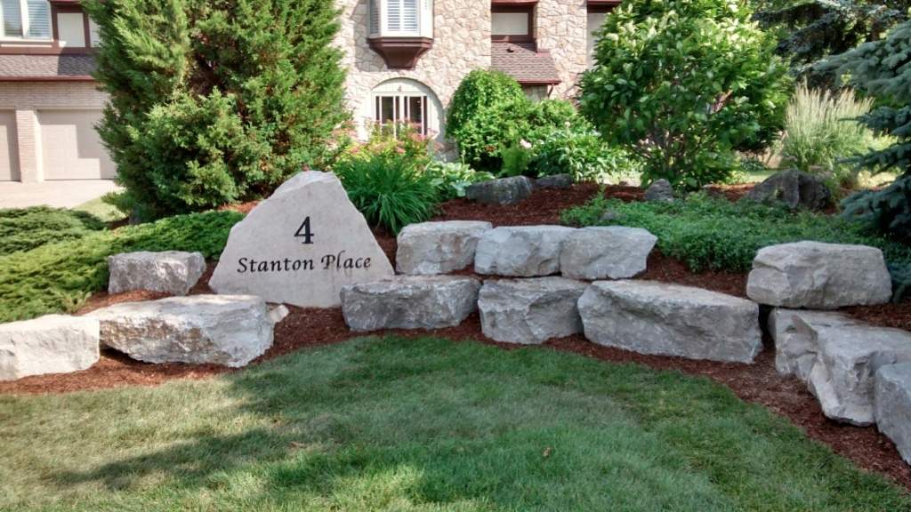 Address rock with small garden