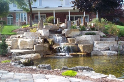 Stone waterfall into pool
