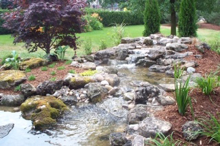 Low waterfall with small pond