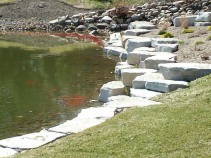 Stone border around pond