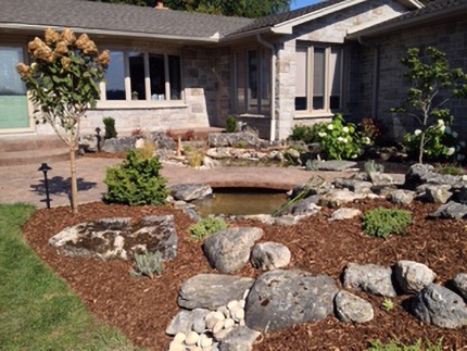 Garden with stone design and pond